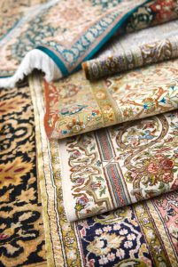 Shallow-focus image of persian silk rugs and oriental carpets.